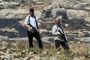Israeli Settlers Build Separation Wall, Assault Palestinian Farmers in West Bank